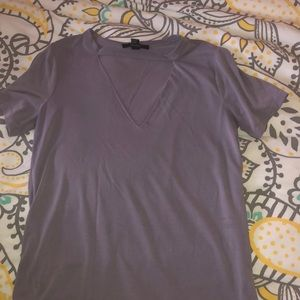 Soft material tee with cutout on chest